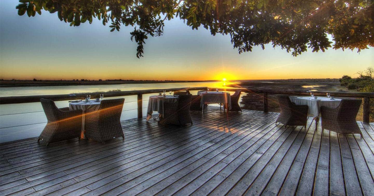 Savour a sundowner at Chobe Safari Lodge